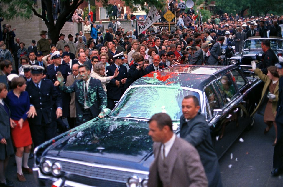 10/21/66: the refurbished JFK death car being pelted with paint during LBJ's trip to Australia