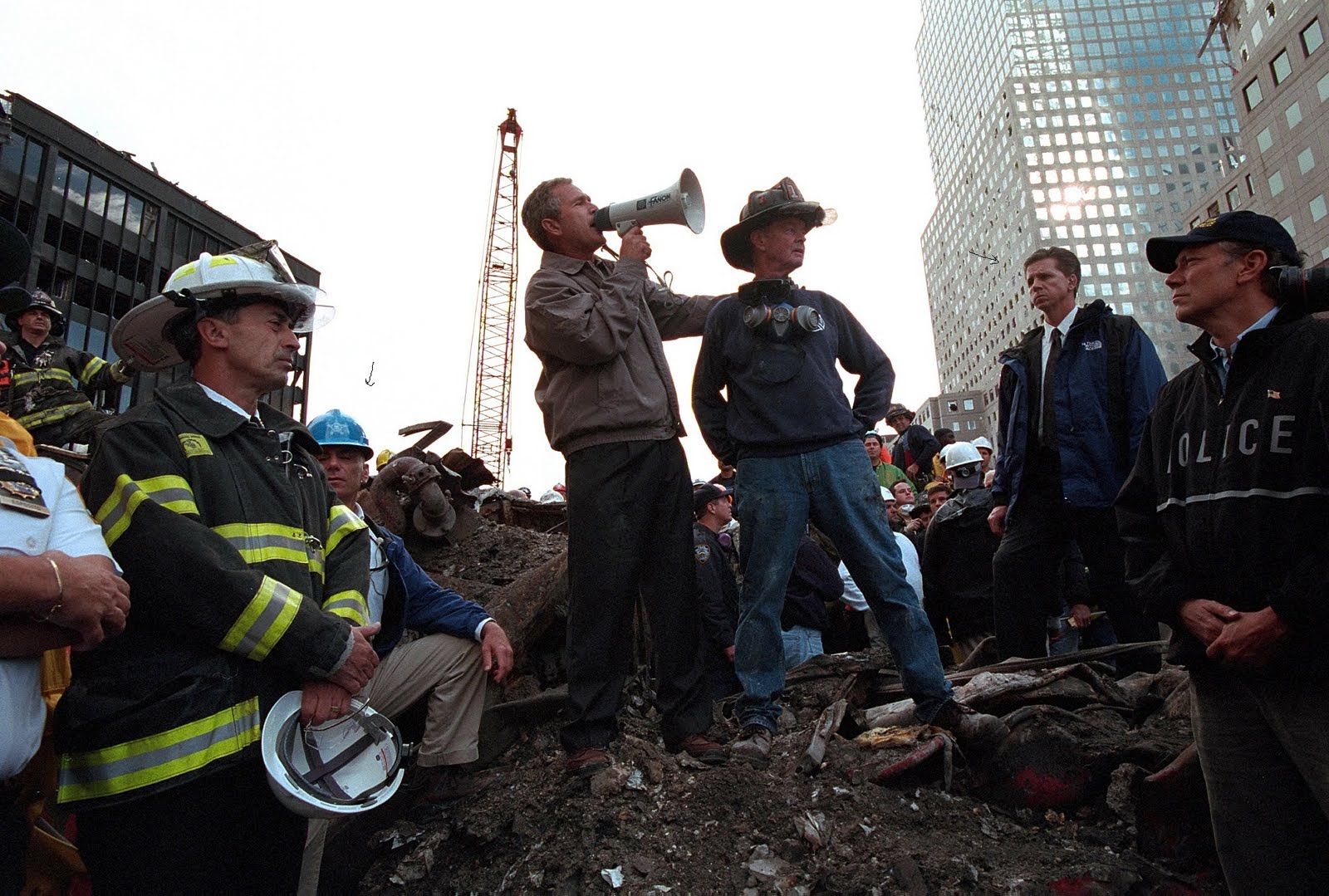 ASAIC Al Concordia (light blue helmet) & SAIC Carl Truscott with President Bush at Ground Zero